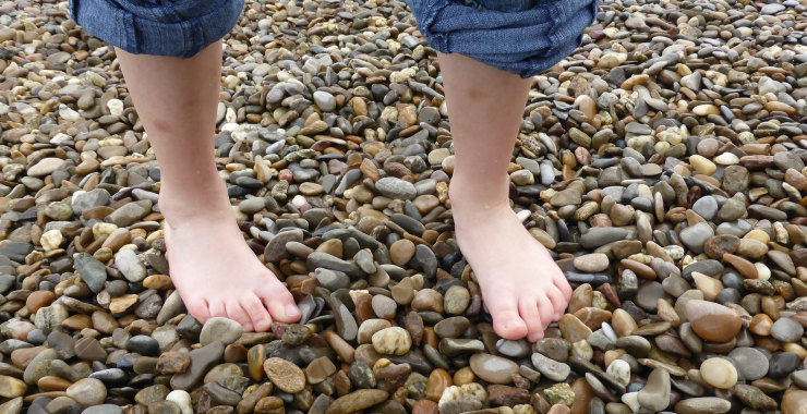 Walking barefoot on stones